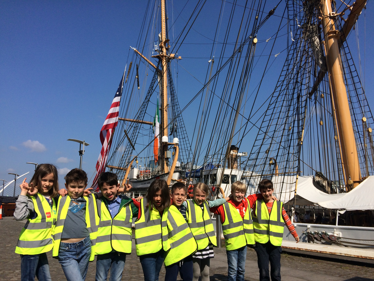 Students on a field trip to visit a ship in Dublin docks.